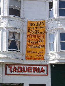 Sign protesting gentrification in the Mission District. [photo by ClockworkGrue via Flickr]