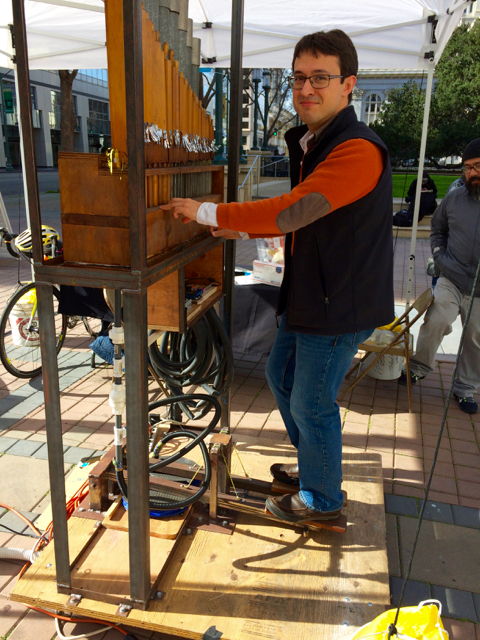 "A board asked us, ""How do you want to play in Oakland?"" and provided stickers--this is a planning exercise after all--to place next to your choice. One of the options was ""Pedal Powered Pump Organ,"" and you know I put my sticker in that box. This is the organ, presented by Oakland industrial arts school The Crucible."
